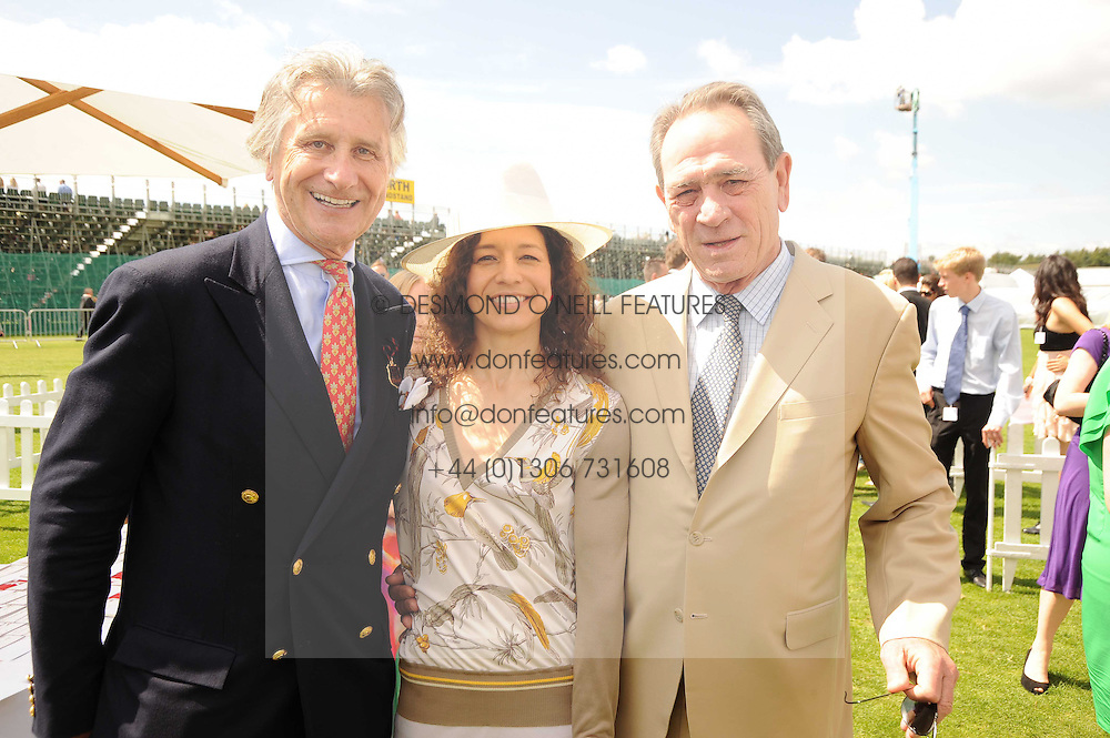 ARNAUD BAMBERGER, TOMMY LEE JONES and his wife DAWN at the Cartier International Polo at Guards Polo Club, Windsor Great Park, Berkshire on 25th July 2010.