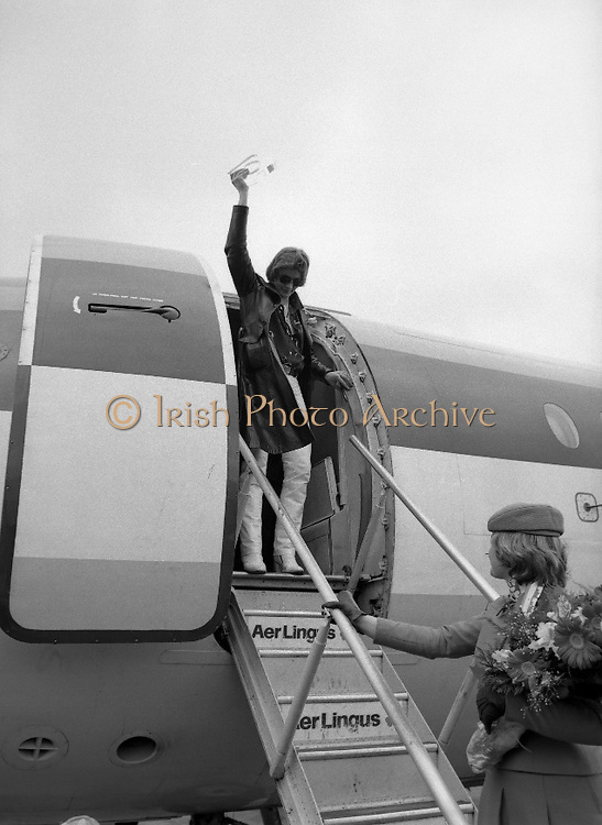 Johnny Logan on his return at Dublin Airport from Holland where he won the Eurovision Song Contest for Ireland with his entry What's Another Year..1980-04-21.21st April 1980.21-04-1980.04-21-80..Photographed at Dublin Airport..Johnny Logan holding up the Eurovision Song Contest trophy.