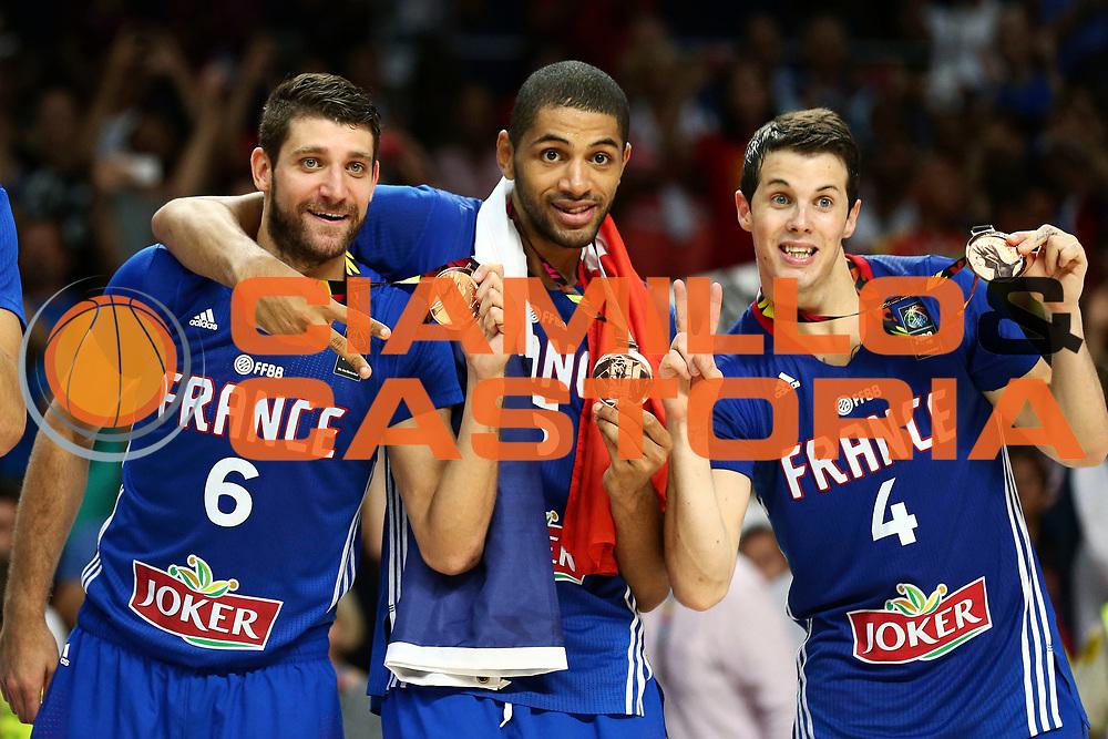 DESCRIZIONE : Madrid FIBA Basketball World Cup Spain 2014 3rd Place Lituania Francia Lithuania France<br /> GIOCATORE : Antoine DIOT Nicolas BATUM Thomas HEURTEL<br /> CATEGORIA : <br /> SQUADRA : Francia France<br /> EVENTO : FIBA Basketball World Cup Spain 2014<br /> GARA :  Lituania Francia Lithuania France<br /> DATA : 13/09/2014<br /> SPORT : Pallacanestro <br /> AUTORE : Agenzia Ciamillo-Castoria/ElioCastoria<br /> Galleria : FIBA Basketball World Cup Spain 2014<br /> Fotonotizia : Madrid FIBA Basketball World Cup Spain 2014 3rd Place Lituania Francia Lithuania France