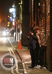 Manchester UK  24.12.2016: Images from Manchesters Gay Village during the Mad Friday celebrations this on the 23 and 24th of December,<br /> <br /> <br /> 2 men stand in a  alleyway