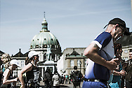 Marathon runners take to the streets of Copenhagen to compete in a shot with Marmor Kirke in the background.