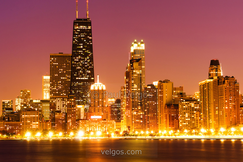 Picture of Chicago night skyline with John Hancock building and other downtown Chicago city buildings. The John Hancock Center building which is one of the tallest buildings in the United States. Photo was taken in 2012, is high resolution and has a toned treatment.