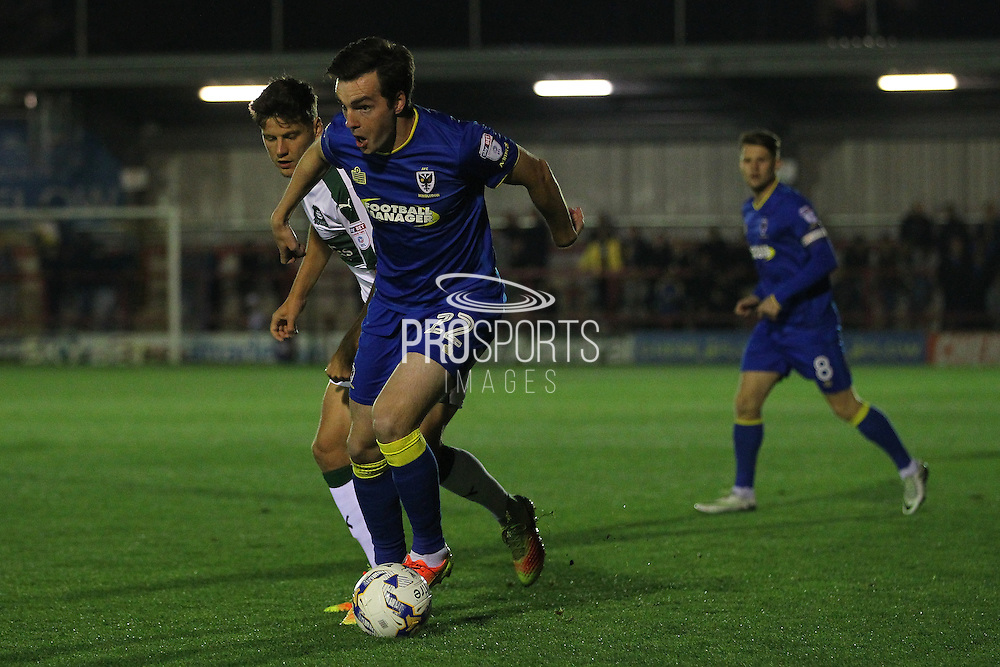 AFC Wimbledon defender Sean Kelly (22) and Plymouth Argyle defender Connor Smith (6) during the EFL Trophy match between AFC Wimbledon and Plymouth Argyle at the Cherry Red Records Stadium, Kingston, England on 4 October 2016. Photo by Stuart Butcher.