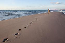 A lone visitor walks along the sandbank at Lombadina on the Dampier Peninsular.