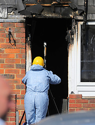 """© Licensed to London News Pictures. 07/08/2018. London, UK. An investigation team at the scene of a house fire in Deptford, east London, in which a 7 year-old boy has died. Six fire engines were called to a """"suspicious"""" fire in the early hours of Tuesday morning. Photo credit: Rob Pinney/LNP"""