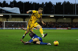 James Clarke of Bristol Rovers skips over the tackle of Jonathan Meades of AFC Wimbledon - Mandatory byline: Robbie Stephenson/JMP - 07966 386802 - 26/12/2015 - FOOTBALL - Kingsmeadow Stadium - Wimbledon, England - AFC Wimbledon v Bristol Rovers - Sky Bet League Two