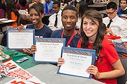 Houston Academy for International Studies students display their certificates during the Academic Signing Day activities at the Region 4 Education Center, May 23, 2014.