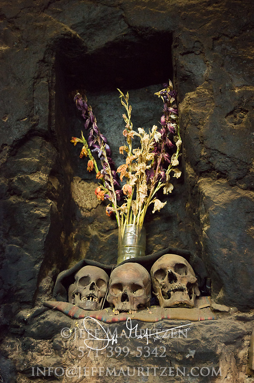 Three skulls on display at a home in Peru, show the practice of bringing back a family members remains to honor and remember.