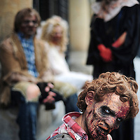 "Actors dressed up like zombies pose as they wait for tram, on September 2, 2010, in the Northern Spanish city of Bilbao. Actors and dancers, dressed up like zombies, visited Bilbao to promote the musical show ""Forever, King of Pop"", based on Michael Jackson's ""Thriller"". PHOTO/Rafa Rivas"