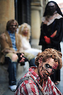 """Actors dressed up like zombies pose as they wait for tram, on September 2, 2010, in the Northern Spanish city of Bilbao. Actors and dancers, dressed up like zombies, visited Bilbao to promote the musical show """"Forever, King of Pop"""", based on Michael Jackson's """"Thriller"""". PHOTO/Rafa Rivas"""
