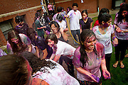 Holi participants laugh and enjoy themselves-thoroughly covered in bright colors and soaked in water-outside Younker Hall on Saturday.<br />