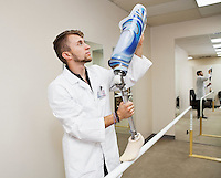 Young technician with advanced prosthetic foot