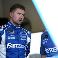 Ricky Stenhouse Jr., driver of the (17) Fastenal Ford is seen in the garage area during practice for the 60th Annual NASCAR Daytona 500 auto race at Daytona International Speedway on Friday, February 16, 2018 in Daytona Beach, Florida.  (Alex Menendez via AP)