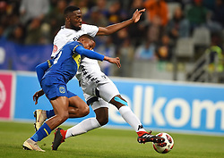 Cape Town-181002- Bidvest Wits  defender Buhle Mkhwanazi challenge Cape Town City's Craig Martin  in a PSL clash at the Cape Town stadium.Wits are fighting to get back the top spot after poor display in their last two games .Photographs:Phando Jikelo/African News Agency/ANA