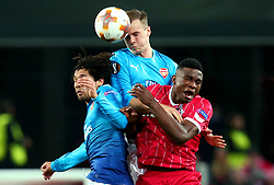 Rob Holding of Arsenal beats teammate Mohamed Elneny of Arsenal and Jhon Cordoba of Cologne to a header - Mandatory by-line: Robbie Stephenson/JMP - 23/11/2017 - FOOTBALL - RheinEnergieSTADION - Cologne,  - Cologne v Arsenal - UEFA Europa League Group H