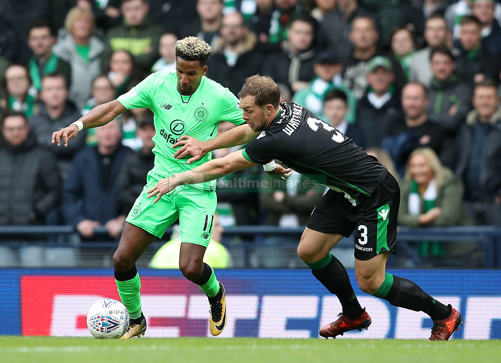 Celtic's Scott Sinclair (left) and Hibernian's Steven Whittaker battle for the ball during the Betfred Cup, semi-final match at Hampden Park, Glasgow. PRESS ASSOCIATION Photo. Picture date: Saturday October 21, 2017. See PA story SOCCER Hibernian. Photo credit should read: Jane Barlow/PA Wire. EDITORIAL USE ONLY