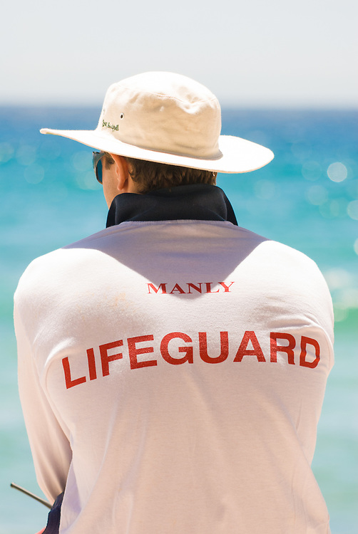 Lifeguard patrolling Manly Beach, Sydney.