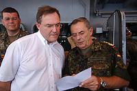 """25 SEP 2006, GOLF VON TADJURA/DJIBOUTI:<br /> Franz Josef Jung (L), CDU, Bundesverteidigungsminister, und Wolfgang Schneiderhan (R), Generalinspekteur der Bundeswehr, auf der Fregatte """"Schleswig-Holstein"""", die als Flaggschiff Teil des deutschen Marinekontingents der OPERATION ENDURING FREEDOM ist und im Seegebiet am Horn von Afrika operiert, Djibouti<br /> IMAGE: 20060925-01-135<br /> KEYWORDS: Dschibuti, Bundeswehr, Marine, Soldat, Soldaten, Afrika, Africa"""