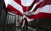The 20 x 30-foot Stars &amp; Stripes is raised and lowered five times a week atop the Two Union Square building (weather permitting) It's one of the most prominent flags on the Seattle Skyline.<br /> <br /> Alan Berner / The Seattle Times