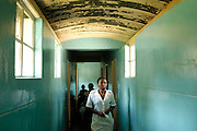 Glendale, Zimbabwe. 2006. -- A nurse walks down the hallway connecting the surgical theatre and out patients department to the male ward. -- The Howard Hospital is a well established Salvation Army rural mission hospital located north of Harare, Zimbabwe. It is so entrenched in the Chiweshe community that they consider it as their own.