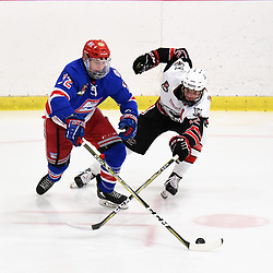 GEORGETOWN, ON - JANUARY 5: Jack Lyons #72 of the Oakville Blades tries to keep the puck from Matt McJannet #12 of the Georgetown Raiders in the second period on January 5, 2019 at Gordon Alcott Memorial Arena in Georgetown, Ontario, Canada.<br /> (Photo by Ken Lamb / OJHL Images)