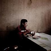 Eating mutton, Urumqi, Xinjiang, China.