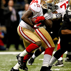 November 25, 2012; New Orleans, LA, USA; San Francisco 49ers running back Frank Gore (21) against the New Orleans Saints during the second half of a game at the Mercedes-Benz Superdome. The 49ers defeated the Saints 31-21. Mandatory Credit: Derick E. Hingle-US PRESSWIRE