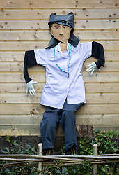 © Licensed to London News Pictures. 27/04/2020. Capel, UK. A scarecrow depiction of a nurse in uniform stands at the front of a house in the Surrey village of Capel. Residents of the village have resurrected their summer tradition of scarecrows in tribute to NHS medical staff and other key workers. Up to 30 of the life size home made doll like characters can be seen in front gardens throughout the village. The public have been told they can only leave their homes when absolutely essential, in an attempt to fight the spread of coronavirus COVID-19 disease. Photo credit: Peter Macdiarmid/LNP