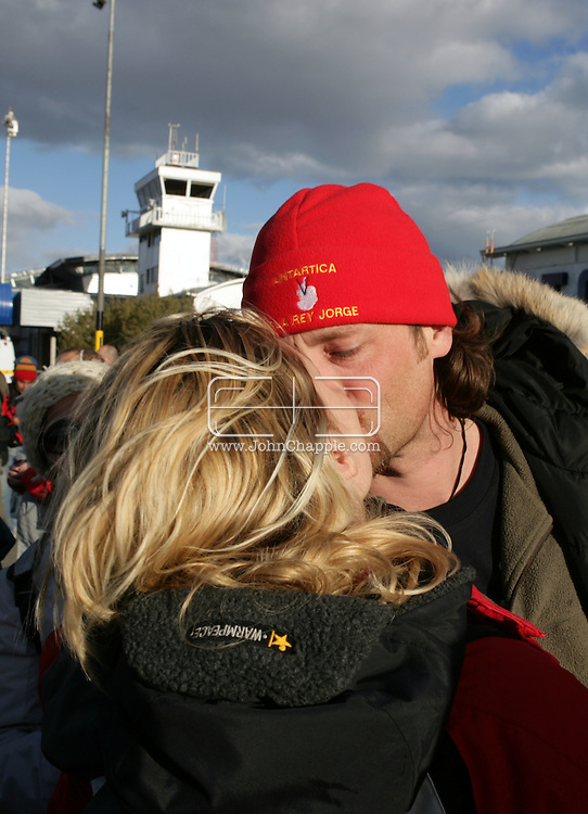 """24th November 2007, Punta Arenas, Chile. Survivors from the shipwrecked Antarctic vessel M/S Explorer arrive at Punta Arenas by military aircraft. 154 tourists and crew had spent the night on King George Island after their ship struck an iceberg and sank approximately 120km (75 miles) north of the Antarctic Peninsula. After several hours bobbing in small lifeboats surrounded by floating sheets of ice, they were plucked to safety by the Norwegian cruise ship, the Nordnorge. The """"Spirit of Shackleton"""" 19-day cruise through the Drake Passage, cost from around $8,000 (£3,900) per cabin. Pictured is Jan Heikel and fiance Mette Larsen from Denmark. Jan had intended to propose  to Mette the next day but when the ship started to sink he grabbed the ring and proposed of the lifeboat. She said yes..PHOTO © JOHN CHAPPLE / REBEL IMAGES.john@chapple.biz   www.chapple.biz"""