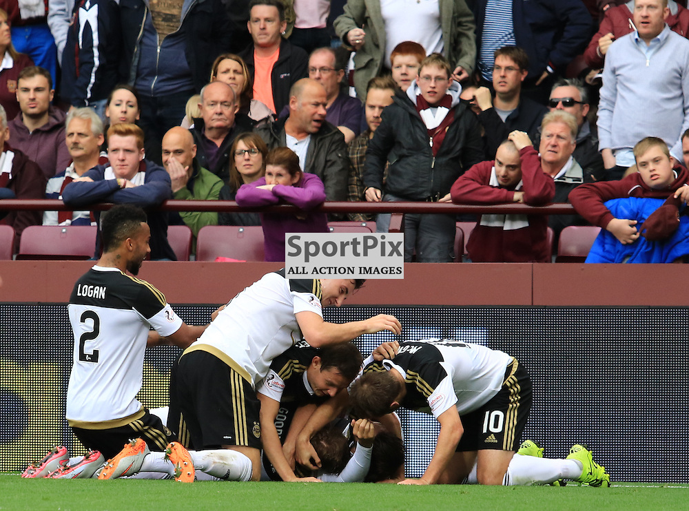 Aberdeen's David Goodwillie is mobbed by team mates after he fires home the third goal during the Heart of Midlothian FC  V Aberdeen FC  Scottish Premiership  20th September 2015  ©Edward Linton   SportPix.org.uk
