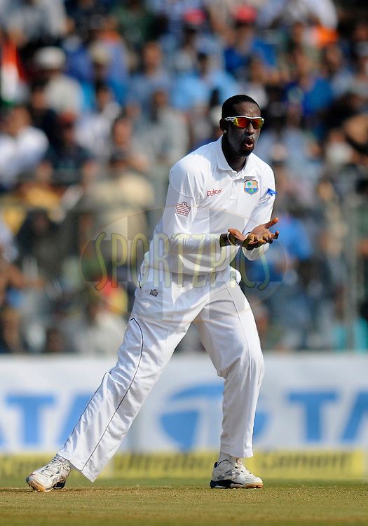 Shane Shillingford of West Indies reacts as he bowls during day two of the second Star Sports test match between India and The West Indies held at The Wankhede Stadium in Mumbai, India on the 15th November 2013<br /> <br /> This test match is the 200th test match for Sachin Tendulkar and his last for India.  After a career spanning more than 24yrs Sachin is retiring from cricket and this test match is his last appearance on the field of play.<br /> <br /> <br /> Photo by: Pal PIllai - BCCI - SPORTZPICS<br /> <br /> Use of this image is subject to the terms and conditions as outlined by the BCCI. These terms can be found by following this link:<br /> <br /> http://sportzpics.photoshelter.com/gallery/BCCI-Image-Terms/G0000ahUVIIEBQ84/C0000whs75.ajndY