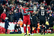 Liverpool defender Andrew Robertson (26) gets the Klopp Hug at the end of the Premier League match between Liverpool and Brighton and Hove Albion at Anfield, Liverpool, England on 30 November 2019.