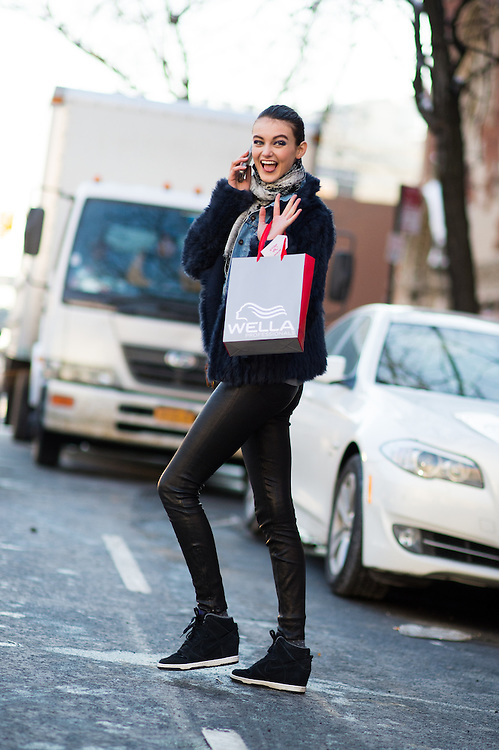 Model Off Duty in Wedge Sneakers, Outside DKNY