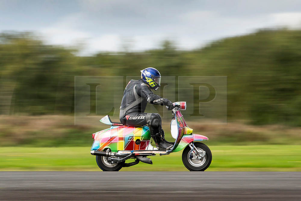 © Licensed to London News Pictures. 16/09/2017. York UK. James Winter races his Vespa 245cc along the runway at the Straighliners Top Speed weekend at Elvington airfield near York today. The eveny is similar to the famous Bonneville land speed events in the US only lower cost & more convenient for Europeans. Photo credit: Andrew McCaren/LNP