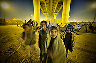 Pilgrims waiting for Mauni Amawasya day, in a camp under Shashtri Bridge..People cannot afford a tent pass over the night near the banks of Sangam, on the roads of Allahabd or near the Shashtri Bridge pillars, waiting for the early morning to bathe in holy river..