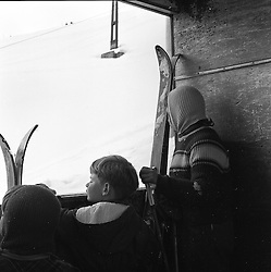 Winter sports enthusiasts in a funicular railway in St.Moritz, Switzerland in February 1960.