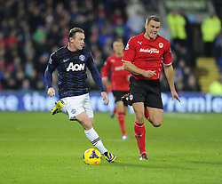 Man Utd Forward Wayne Rooney (ENG) battles for the ball with Cardiff City Defender, Ben Turner (ENG) - Photo mandatory by-line: Joseph Meredith/JMP - Tel: Mobile: 07966 386802 - 24/11/2013 - SPORT - FOOTBALL - Cardiff City Stadium - Cardiff City v Manchester United - Barclays Premier League.