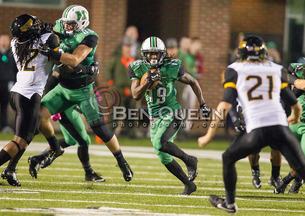 Oct 9, 2015; Huntington, WV, USA; Marshall Thundering Herd wide receiver Deandre Reaves returns a kickoff during the second quarter against the Southern Miss Golden Eagles at Joan C. Edwards Stadium. Mandatory Credit: Ben Queen-USA TODAY Sports