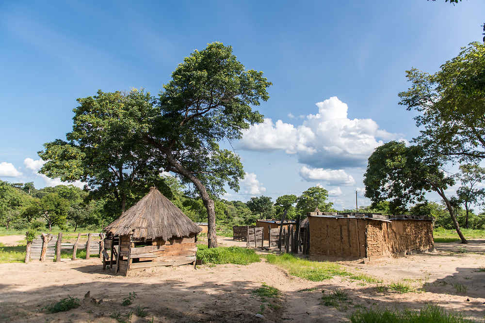 Landscape of traditional small village set against blue skies, Livingstone, Zambia