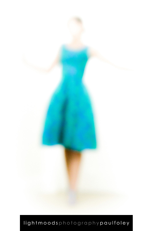 Out of focus woman wearing aqua dress