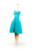 Out of focus woman wearing aqua dress