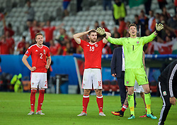 LILLE, FRANCE - Friday, July 1, 2016: Wales' Chris Gunter, Sam Vokes and goalkeeper Wayne Hennessey celebrates after a 3-1 victory over Belgium and reaching the Semi-Final during the UEFA Euro 2016 Championship Quarter-Final match at the Stade Pierre Mauroy. (Pic by David Rawcliffe/Propaganda)