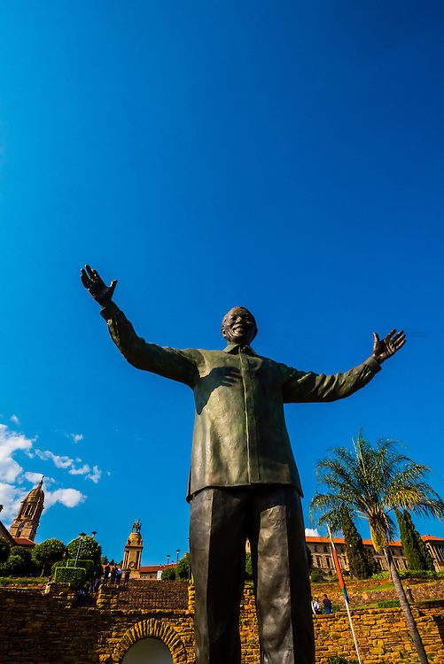 30 foot (9 meter) tall bronze statue of Nelson Mandela with the Union Buildings in background, Pretoria, South Africa.