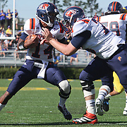 Bucknell  Quarterback Brandon Wesley (14) scrambles out of the pocket during a Week 3 NCAA football game against Delaware...#13 Delaware defeated The Bison of Bucknell 19 - 3 at Delaware Stadium Saturday Sept. 15, 2012 in Newark Delaware.