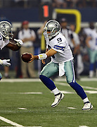Dallas Cowboys quarterback Tony Romo (9) hands off the ball on a first quarter running play during the NFL week 6 football game against the Washington Redskins on Sunday, Oct. 13, 2013 in Arlington, Texas. The Cowboys won the game 31-16. ©Paul Anthony Spinelli