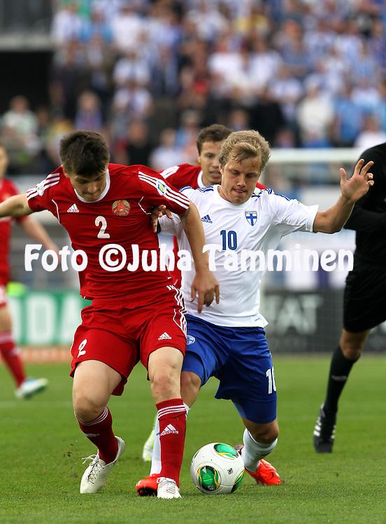 7.6.2013, Olympic Stadium, Helsinki, Finland.<br /> FIFA World Cup 2014 Qualifying match Finland v Belarus / MM-karsintaottelu Suomi - Valko-Ven&auml;j&auml;.<br /> Stanislav Dragun (Belarus) v Teemu Pukki (Finland).