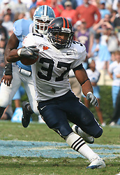 Cedric Peerman (37) cuts up field against the University of North Carolina.  The University of Virginia fell to the Tar Heels 7-5 in Chapel Hill, NC on October 22, 2005.<br />