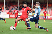 Crawley Town Midfielder Billy Clifford (18) looks to release the ball under pressure from Blackpool midfielder Jim McAlister (4) during the EFL Sky Bet League 2 match between Crawley Town and Blackpool at the Checkatrade.com Stadium, Crawley, England on 1 October 2016. Photo by David Charbit.