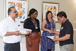 Care UK's Franklin House care home in West Drayton, London, has been awarded a Two Years Pressure Prevention Award from North West London NHS Foundation, in collaboration with Hillingdon TVN Team and Hillingdon CCG. Maintenance Man Rogelio Baluyot, right, receives his award for 10 years service. London, July 11 2019.