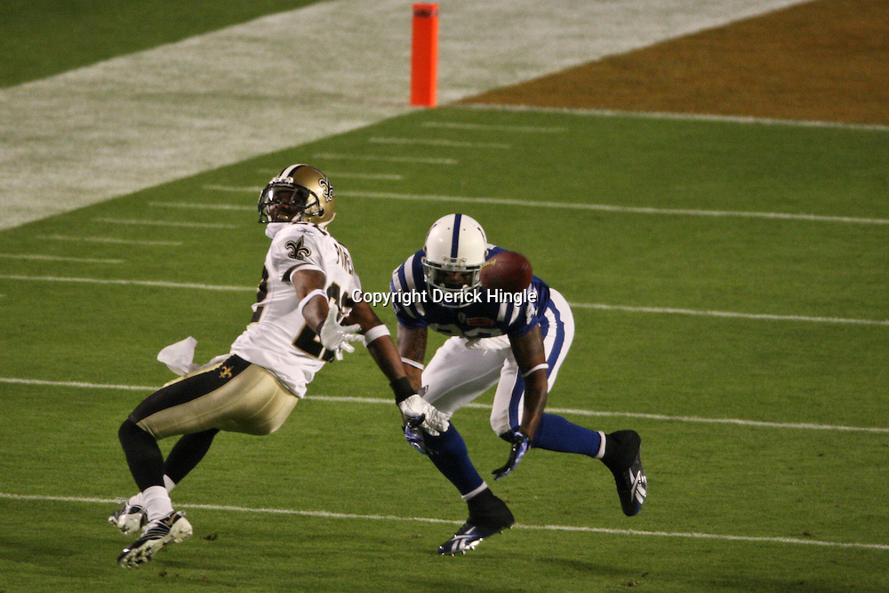 2010 February 07: New Orleans Saints cornerback Tracy Porter (22) defends against Indianapolis Colts wide receiver Reggie Wayne (87) during a 31-17 win by the New Orleans Saints over the Indianapolis Colts in Super Bowl XLIV at Sun Life Stadium in Miami, Florida.